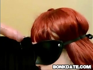 Blindfolded redhead gets deepthroat