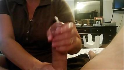 Chubby lass gives a handjob